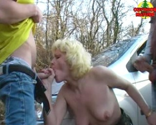 Horny mature slut doing two guys in and out a car