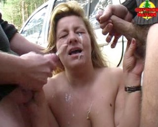 Getting cum from two guys on her face