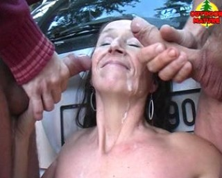 Mature slut getting cum all over her face