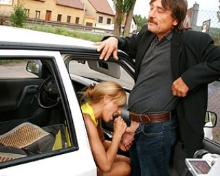 Horny MILF sucking two guys off from a car